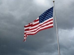 Flag Against Storm Clouds by Moniquef12
