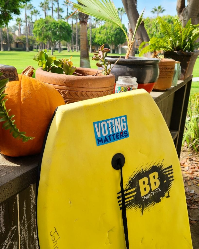 Yellow Boogie Board with Voting Matters Sticker